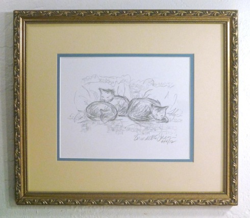 framed pencil sketch of cats on a bed