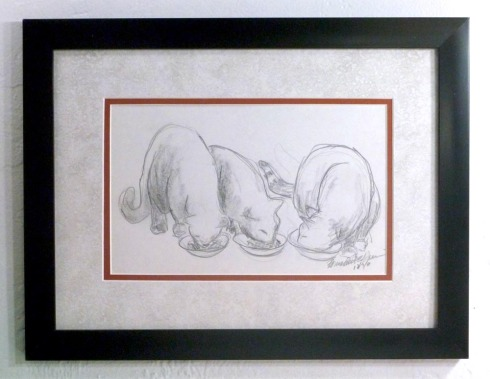 framed pencil sketch of three cats eating
