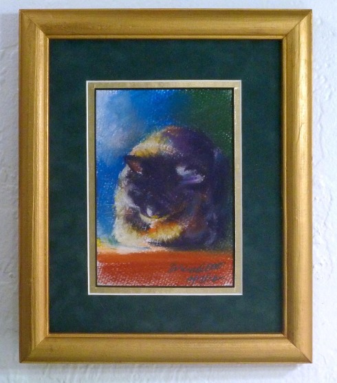 framed painting of sleeping cat